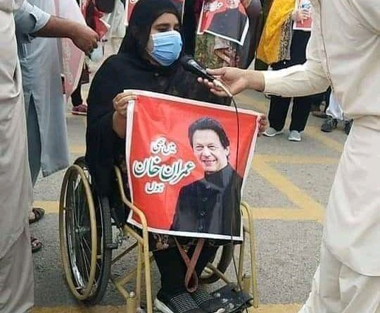 A PTI worker on wheelchair at the D-Chowk
