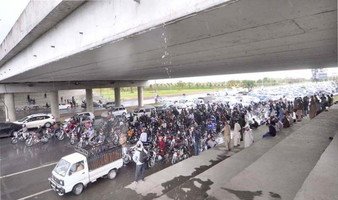 A large number of motorcyclists getting shelter under the Shakarparian over bridge during the heavy rain that experienced in the twin cities