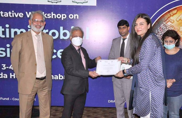 Chief Executive Officer Drug Regulatory Authority of Pakistan (DRAP) Asim Rauf awarding certificates among the participants during closing ceremony of Consultative Workshop on Antimicrobial Resistance (AMR)