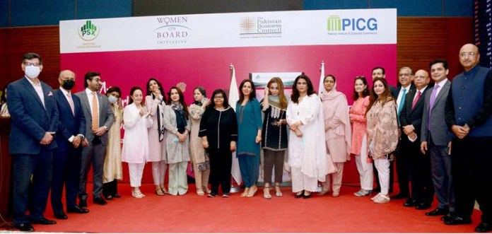 A group photo of eminent women leaders and inspirational women of Pakistan with Chairman PSX Suleman Mehdi and CEO PSX Farrukh H Khan after a gong ceremony to celebrate International Women's Day at PSX