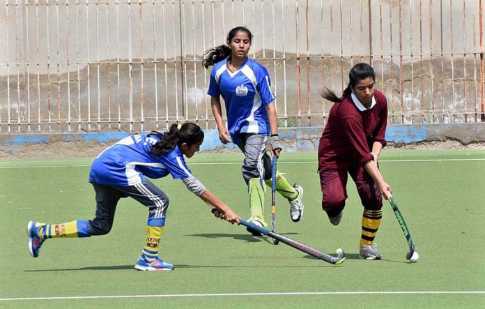 Players of Bahawalpur and Larkana hockey teams struggling to get hold on the ball in the final match during All Pakistan Inter Board Girls Hockey Championship 2021 played at MA Khuhro Sports Complex organized by Board of Intermediate and Secondary Education