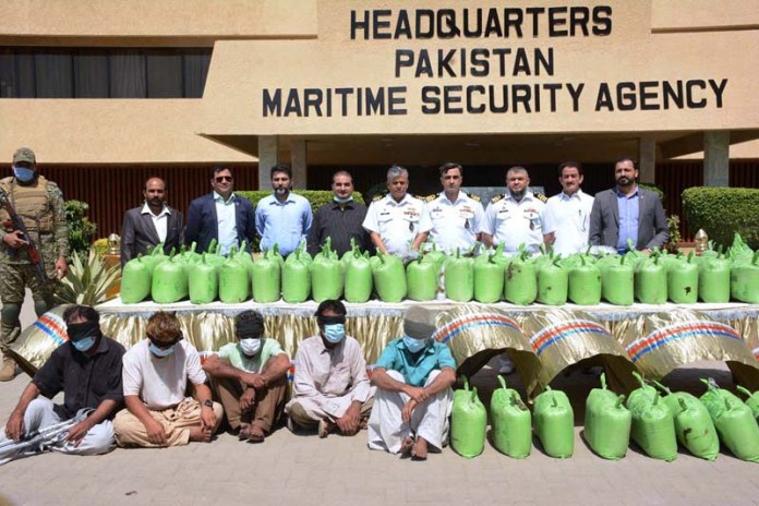 A group photo of officers of Pakistan Maritime Security Agency (PMSA) and Pakistan Customs Intelligence with the seized drugs and arrested accused