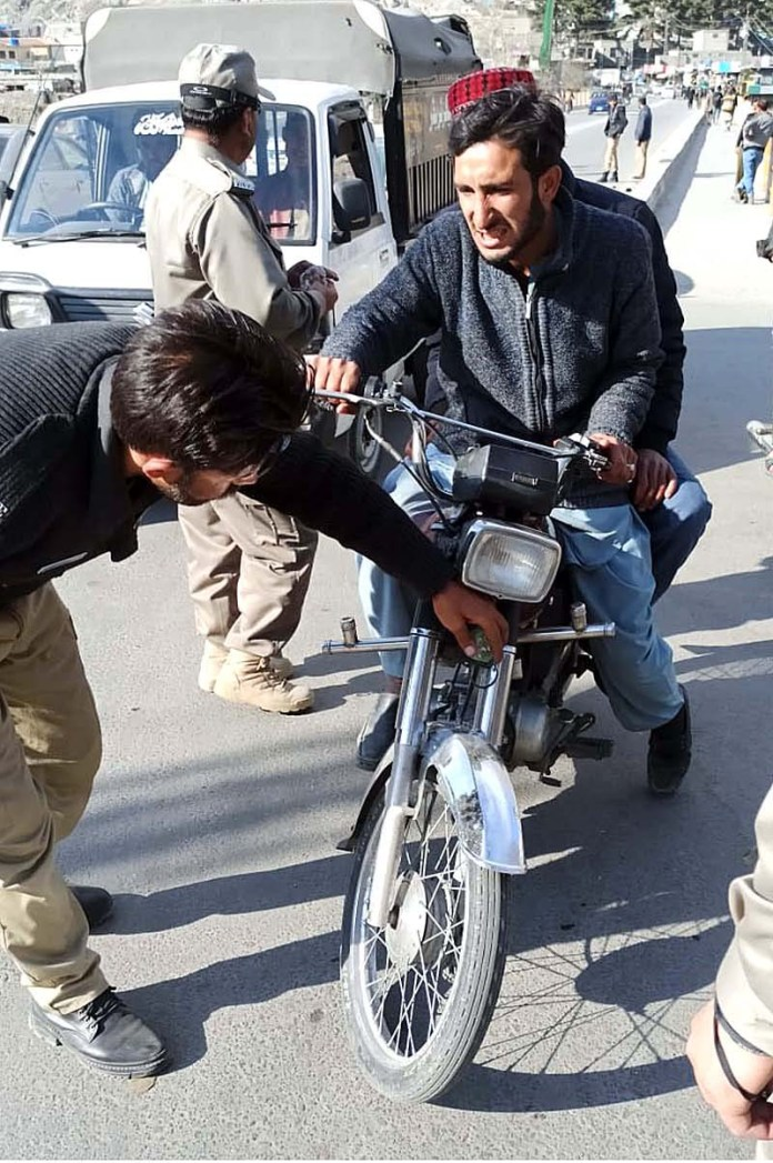 City traffic police personnel removing and crackdown against illegal LED lights of bikes