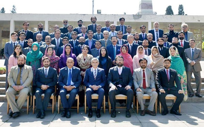 A group photo of Director General, National Institute Management with officers of Mid Career Management Course at NIM
