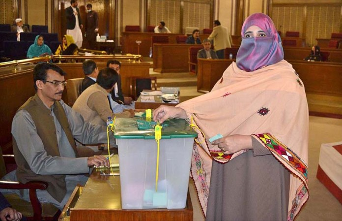 A MPA casting her vote in Balochistan Assembly during processes of senate election