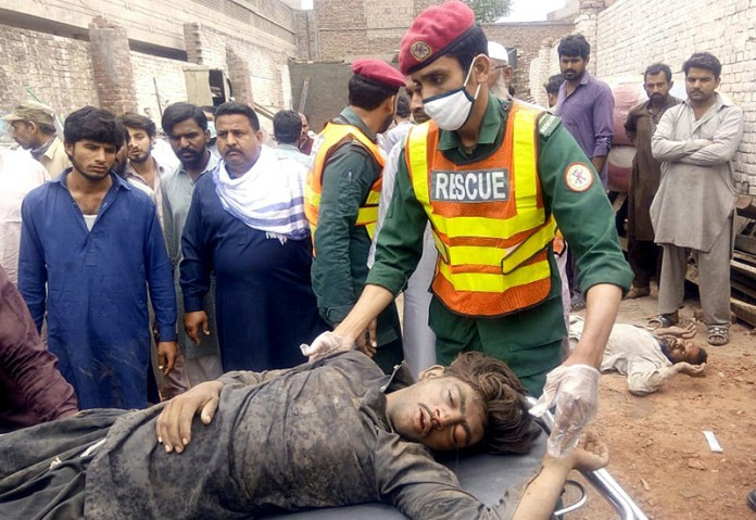 Rescue 1122 official shifting to hospital injured people after falling roof of workshop at Chowk Shah Abbas