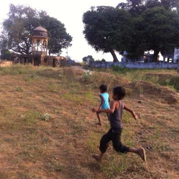 some children running to see us in the village