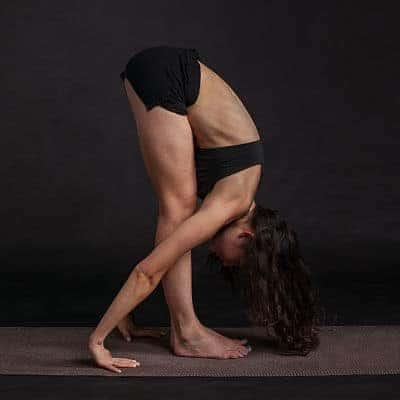 Flat belly woman doing yoga
