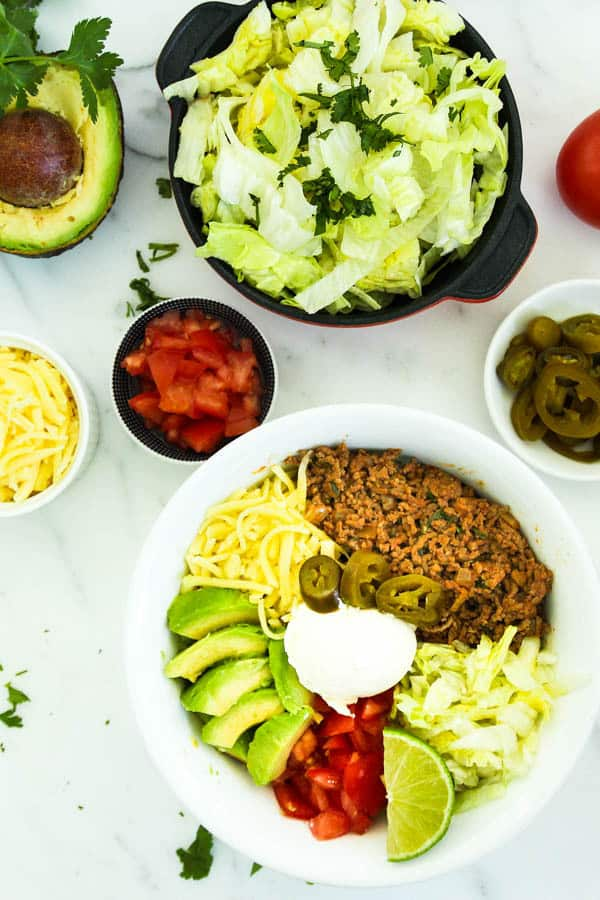 Burritos or tacos are an excellent choice if the rest of your family eat carbs.They are ready in 30 minutes with only 10g net carbs per serve. Ketogenic taco recipe | Keto diet recipes | 30 Minute low-carb recipe |Taco Tuesday | Atkins Diet| Banting | Beef Tacos | Gluten-Free Tacos | Low-carb burrito bowl #lowcarbrecipes #ketorecipes #lowcarbtaco #tacobowl