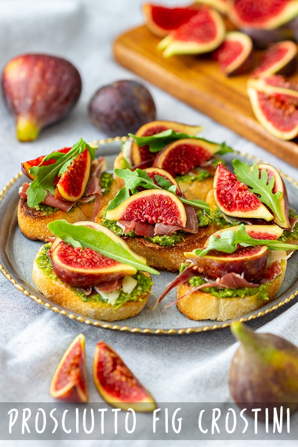 Prosciutto fig crostini toasts are flavorful little bites perfect for any occasion! These bite-size appetizers are easy to make and take only minutes to put together. #appetizeraddiction #prosciutto #figs #crostinis #recipe #fingerfood #partyfood #appetizers #parmaham #jamon