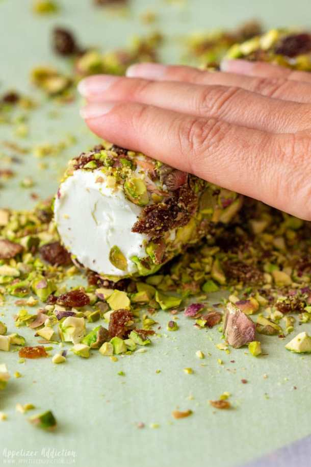 Rolling the Goat Cheese Log on the crushed pistachios