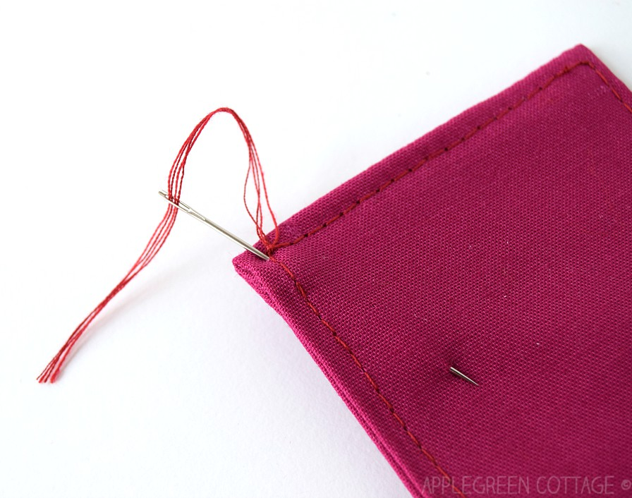 using needle to hide thread ends