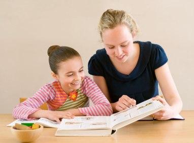 A person tutoring a kid