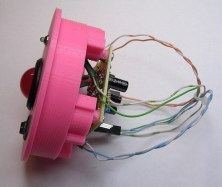 Image of the assembled PCB and 3D-printed enclosure for the doorbell alert light device (side view)