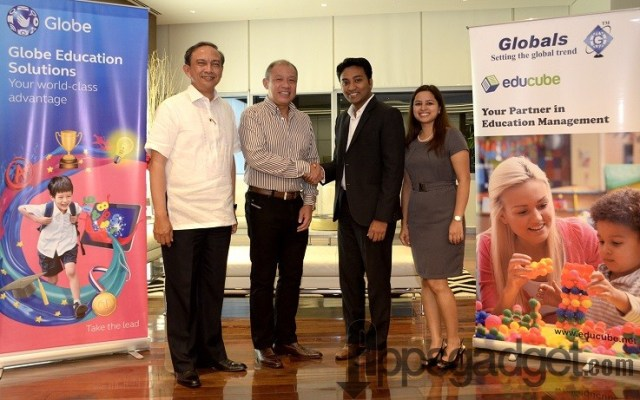 Globe Telecom executives led by (from left) EVP & COO Gil Genio and President & CEO Ernest Cu, together with Globals CEO Suhas Gopinath and Vice President for Strategy & Marketing Amruta Desai seal their partnership to introduce a school management system for Philippine learning institutions.