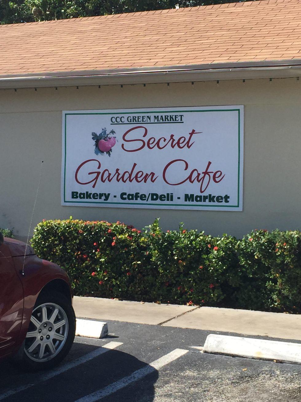 secret garden cafe sign