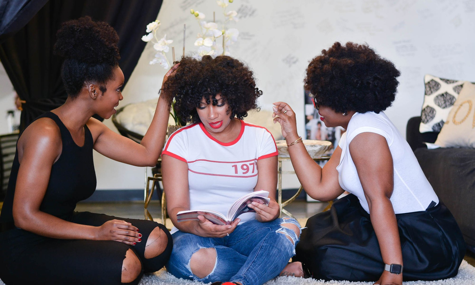 Women with natural hairstyles, enjoying each other's company.