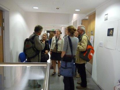 impromptu meeting in the hallway