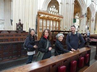 Cindi, Eva, Keiko and Daniel touch the nice wood