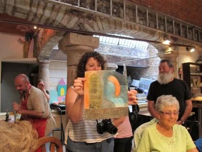 Renee holds Hugo's print