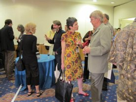 Joan Winter chats with Paul Furneaux; Claire Cuccio with Kari Laitinen