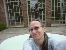 April with sculpture in front of the Orangery
