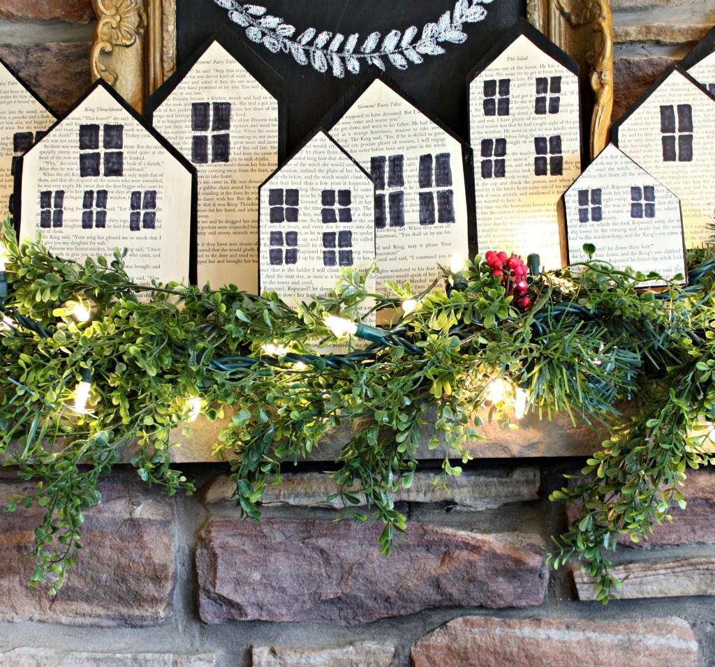Christmas Wood Block Houses that were made using scrap wood, old book pages and glue. This easy DIY Christmas decor idea was seen first on apurdylittlehouse.com