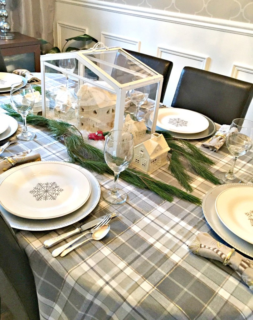 A Christmas Home Tour featuring a grey plaid table setting with silver accents and a white miniature Christmas village at apurdylittlehouse.com