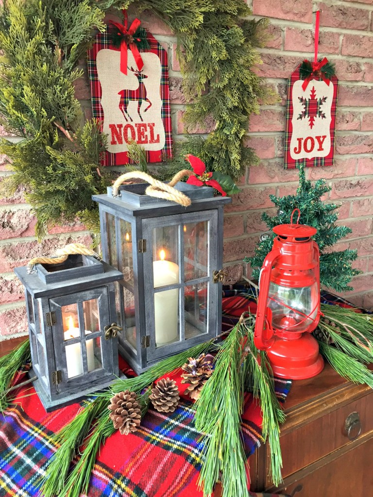 Christmas Home Tour featuring a front porch vignette in plaid with lanterns as accents at apurdylittlehouse.com