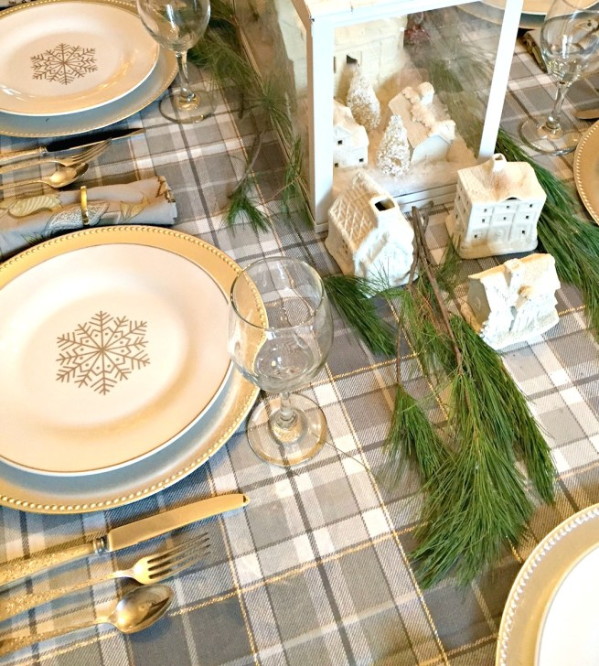 Christmas Home Tour featuring a grey plaid table setting with silver accents and a white miniature Christmas village at apurdylittlehouse.com