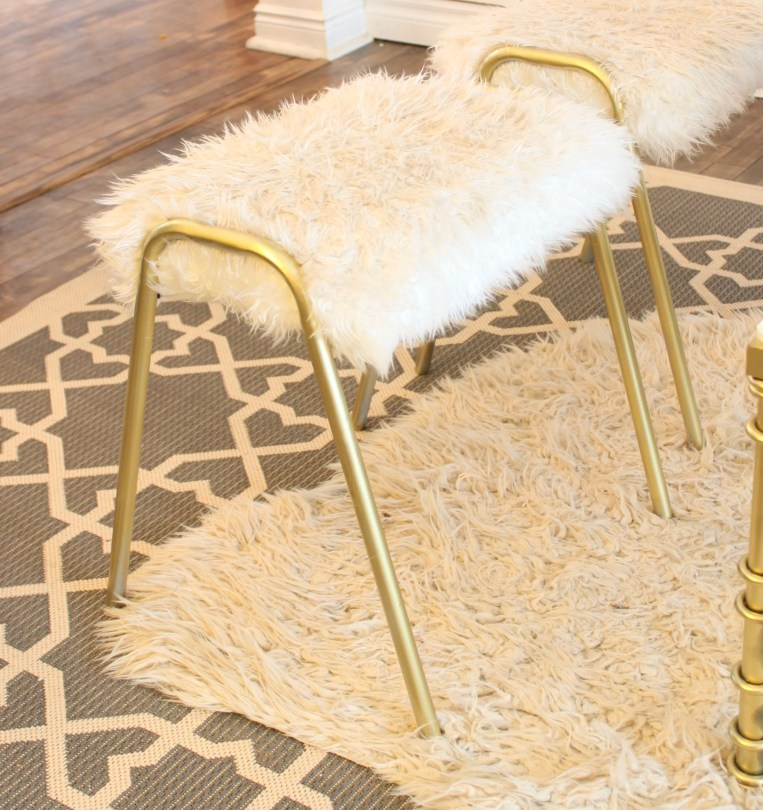 How to Reupholster an Old Stool using fuzzy fun fur and gold spray paint. See how I brought this old stool into the 21st century