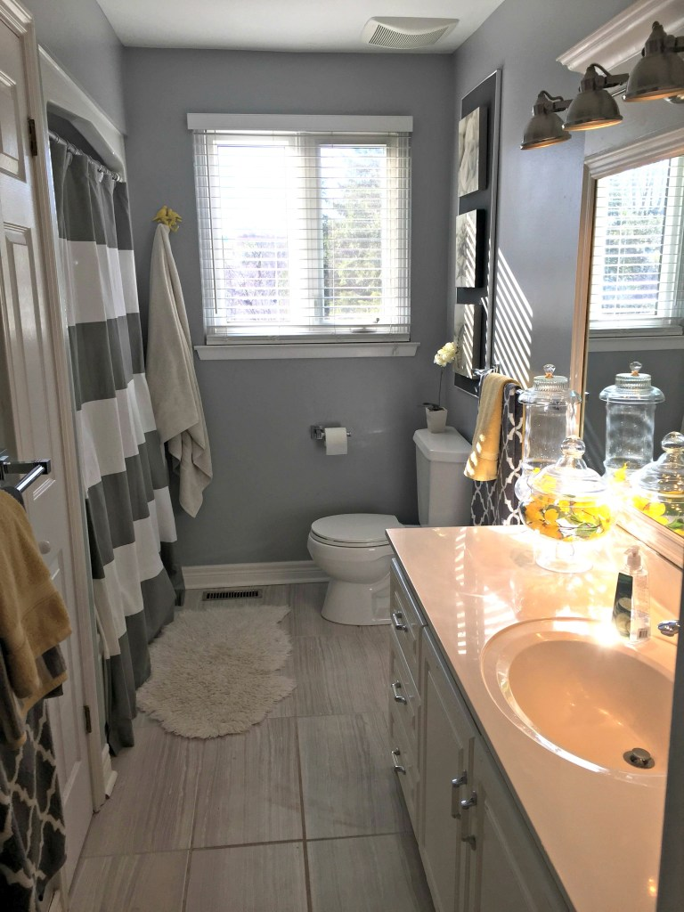 Bathroom Refresh with new tile, paint and decor items at apurdylittlehouse.com