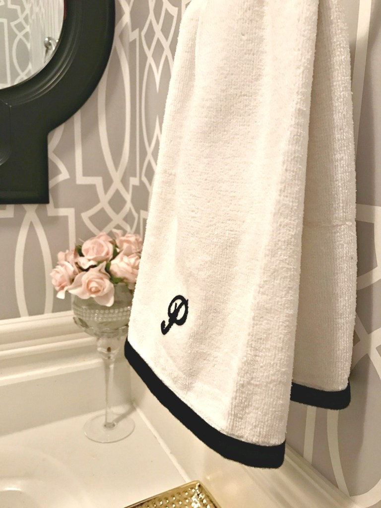 Powder Room Update - Week 4. Monogram Hand Towels. See how I made these personalized towels for a fraction of the cost using some basic DIY techniques at apurdylittlehouse.com