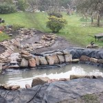 Wildlife pond: Excess underlay and liner is removed and the pond is washed out
