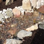 Wildlife pond Bristol - Pebbles and rock are placed to direct the water