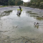 Commercial pond de-silting