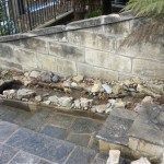 A natural stone watercourse water feature