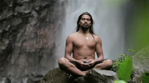 stock-footage-man-doing-sitting-meditation-at-waterfall-in-the-tropics (1)