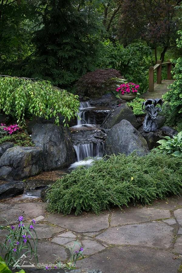 pondless waterfall backyard landscape