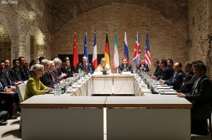 Negotiators of Iran and six world powers face each other at a table in the historic basement of Palais Coburg hotel in Vienna April 24, 2015. Nuclear talks are making good but slow progress as they work towards a June 30 deadline for a final deal, Tehran's senior negotiator Abbas Araqchi said on Friday. REUTERS/Heinz-Peter Bader - RTX1A5DP