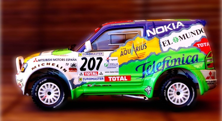 A car with stickers and names of its sponsors all over its body