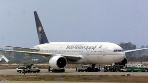 BAGHDAD, IRAQ:  The Saudi Arabian Airlines Boeing 777, hijacked while on a Jeddah-London flight, sits on the tarmac at Baghdad's Saddam International airport before taking off to Riyadh 15 October 2000. The plane left about 24 hours after landing in the Iraqi capital with its 90 passengers and 14 crew aboard. The hijackers, now in the hands of the Iraqi authorities, were both Saudi sergeants who called for an inquiry into human rights abuses in Riyadh and requested political asylum. (Photo credit should read KARIM SAHIB/AFP/Getty Images)