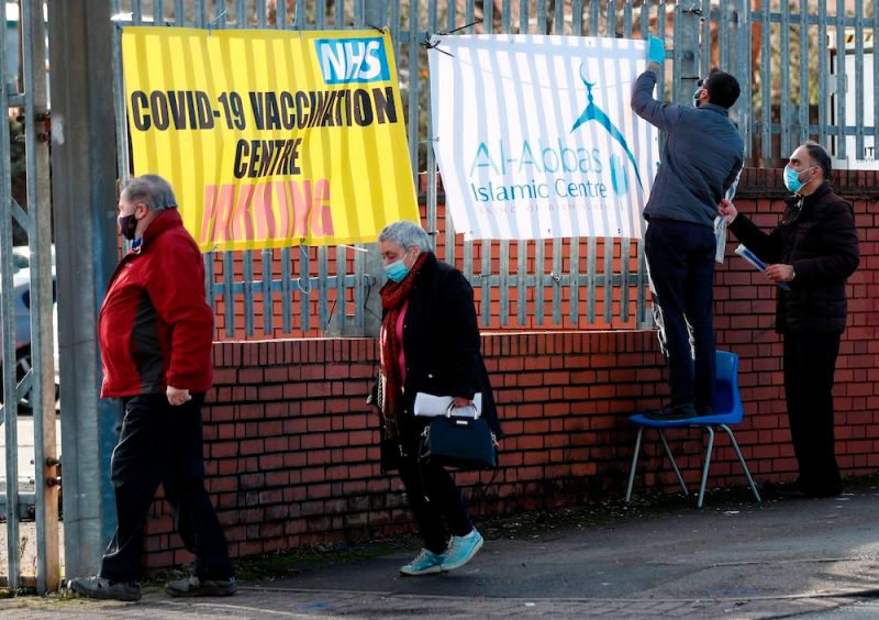 People queue to receive the Oxford/AstraZeneca Covid-19 vaccine at the Al-Abbas Islamic Centre, which has been converted into a temporary vaccination centre in Birmingham, central England on January 21, 2021. (AFP)