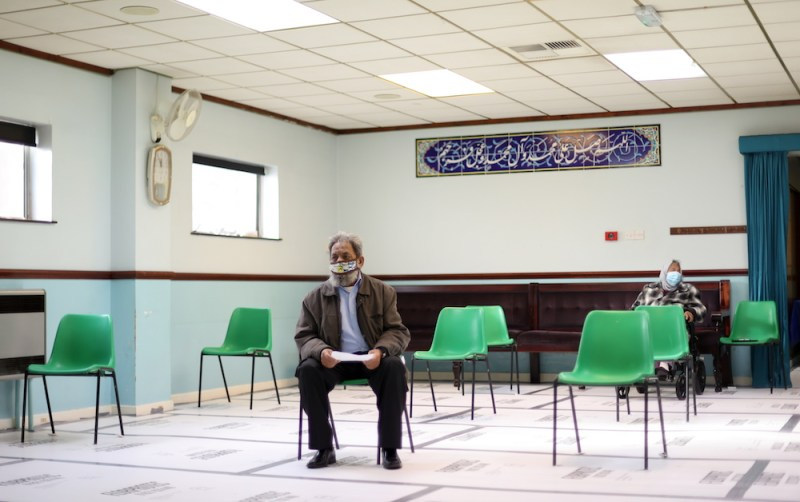 A man waits to receive the coronavirus disease (COVID-19) vaccine, at the Al-Abbas Islamic Centre, in Balsall Heath, Birmingham, Britain, January 21, 2021. (Reuters)