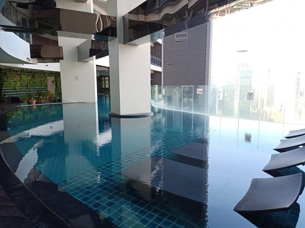"ALT=""gramercy residences zen rooms and the stunning view of the pool"""