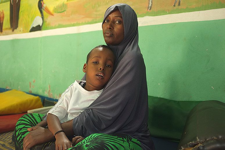 Deequa, 25, with her five-year-old son, Sakeria, whom she has been bringing to the Disability Action Network for physiotherapy for the past year. (Photo: Amanda Sperber)