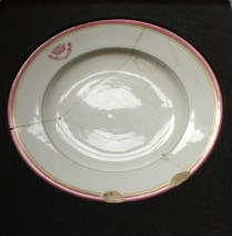 Plate decorated with the Naval College's crest - image: ORNC