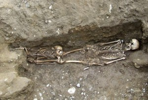 The skeleton of an adult and a small child. The child lay within a coffin placed above the adult coffin, and only later fell into the lower coffin.  Credit: Margaret Gowen & Co. Ltd.