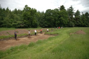 Diggers standing by each of the pits during excavation 2005