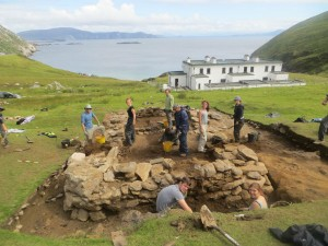 Students in 2015 excavating the foundations of a small cottage in the heart of the settlement at Keem Bay. (Photo: Achill Archaeological Field School)